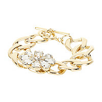 Gold tone gem stone flower curb bracelet