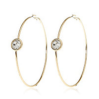 Gold tone single stone hoop earrings