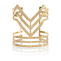 Gold tone cut out cuff bracelet
