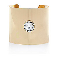 Gold tone single gem stone cuff bracelet