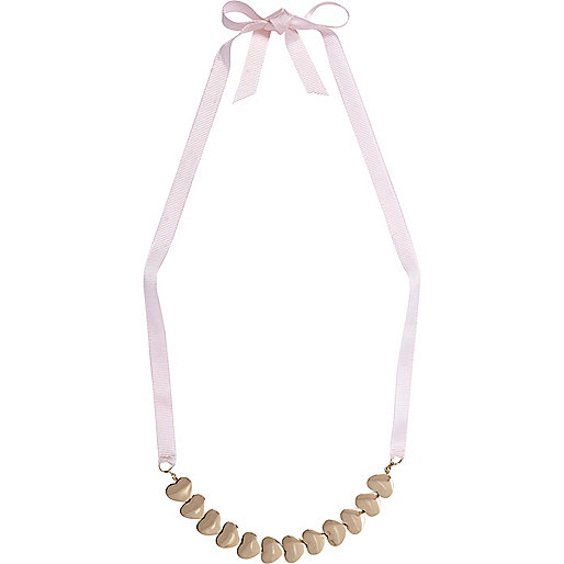 Gold tone repeat heart ribbon necklace