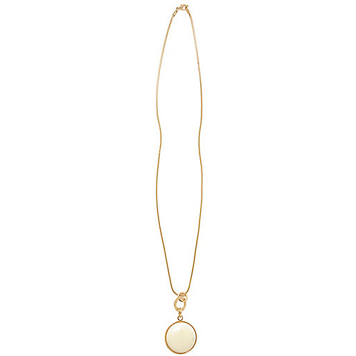 Cream and gold tone pendant necklace