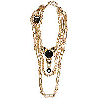 Gold tone Leopard head draped necklace