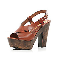 Tan cross strap wooden platform sandals