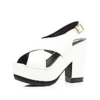 White chunky cross strap platforms