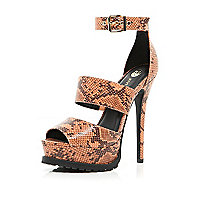 Orange snake cleated sole platform sandals