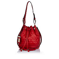 Red diamond quilted duffle bag