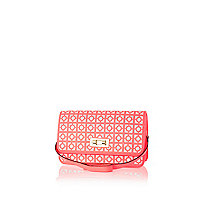 Coral geometric laser cut underarm bag