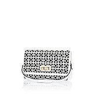 Black and white laser cut underarm bag