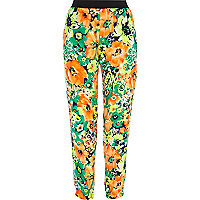 Orange floral print trousers