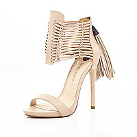 Light pink strappy tassel platforms
