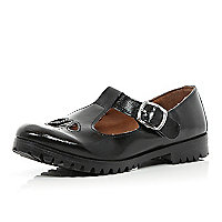 Black patent T bar cut out shoes