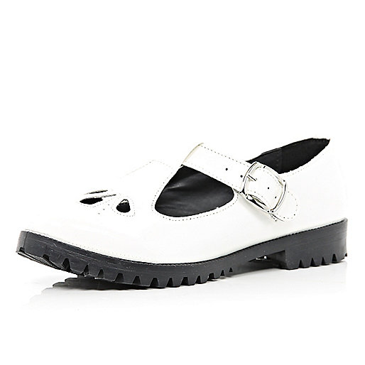White patent T bar cut out shoes