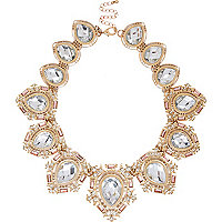 Gold tone crystal repeat statement necklace