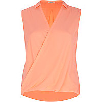 Coral sleeveless wrap blouse