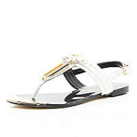 White metal trim T bar sandals