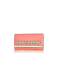 Coral gem stone embellished clutch bag