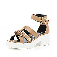Tan tassel buckle cleated sole sandals