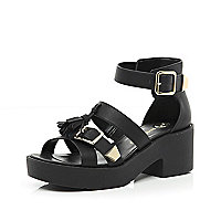 Black tassel buckle cleated sole sandals