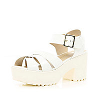 White cross strap cleated sole sandals