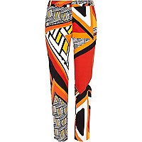 Red abstract print slim cigarette pants