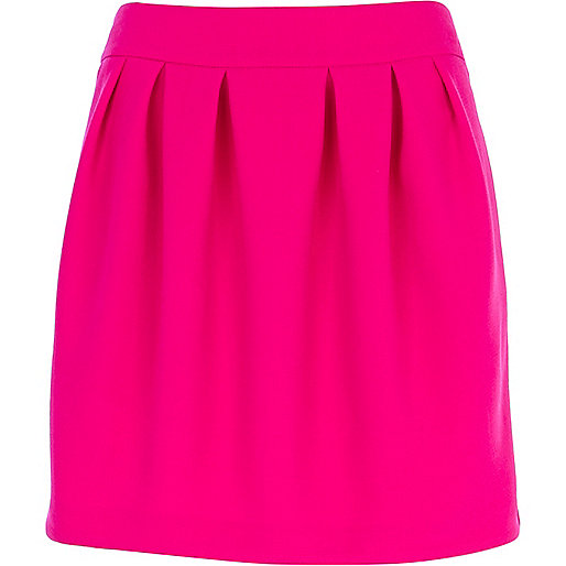 Bright pink box pleat mini skirt