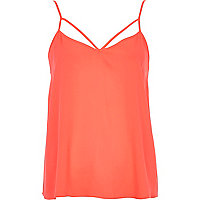 Bright pink cut out strap cami top
