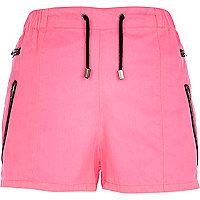 Bright pink zip pocket runner shorts