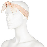 Light pink RI logo head scarf.
