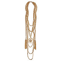Gold tone multi row chain medallion necklace