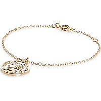 Gold tone coin charm bracelet
