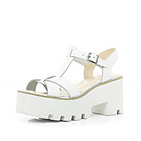 White cleated sole block heel sandals