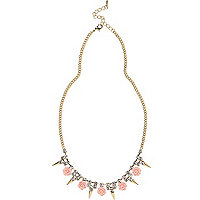Gold tone rose and spike repeat necklace