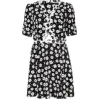 Black and white cut out floral tea dress