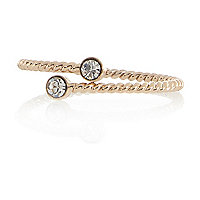 Gold tone twisted diamante thumb ring