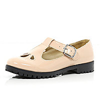 Light pink patent T bar cut out shoes