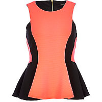 Bright pink ribbed peplum top