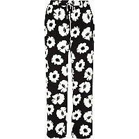 Black and white floral print slouch trousers