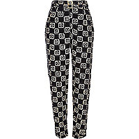 Black geometric print belted trousers