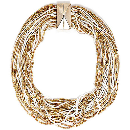 Gold tone and white beaded necklace