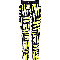 Yellow art print jogger trousers