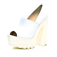 White cleated sole peep toe platforms