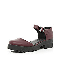 Dark red two-part cleated sole shoes