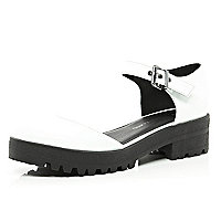 White two-part cleated sole shoes