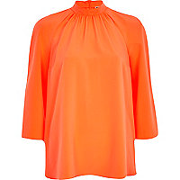 Orange Chelsea Girl high neck blouse