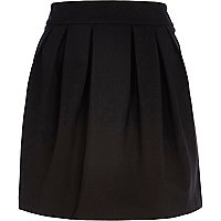 Black pleated A line mini skirt