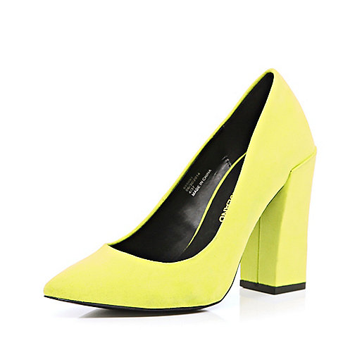 Bright yellow angular court shoes