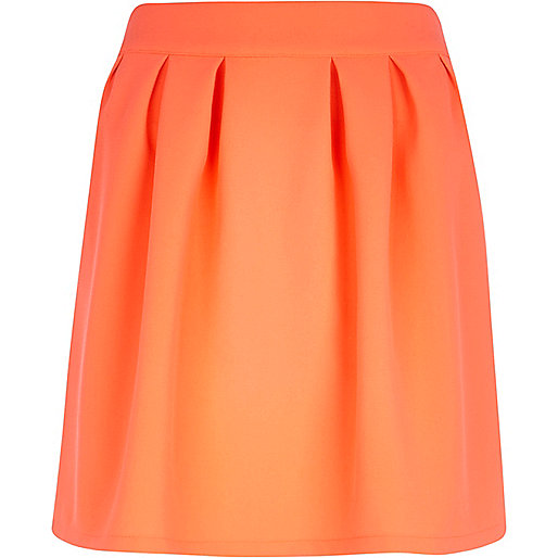 Bright orange pleated mini skirt