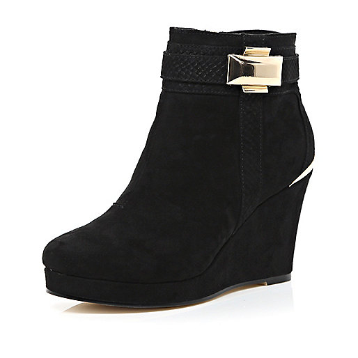 Black metal trim wedge ankle boots