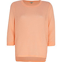 Coral stepped hem jumper